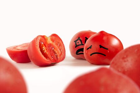 Cartoon ripe tomatoes on a white background are sad about a cut friend among other tomatoes