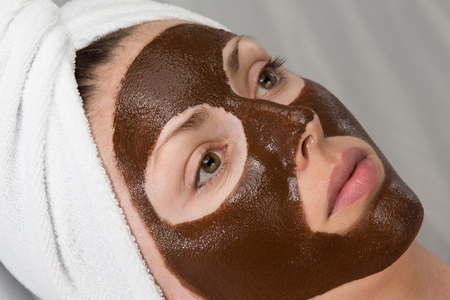 woman with chocolate face-pack