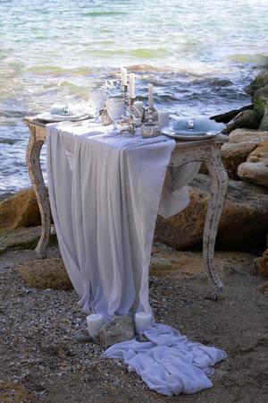Wedding table decoration on a seashore Stock Photo