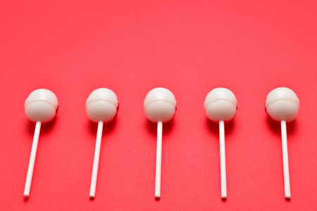 Lollipop on a red background. Space for text or design. Imagens