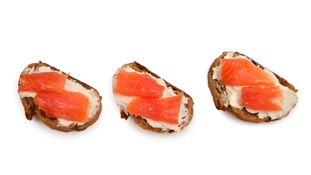 Salmon on a bread with cream isolated on white. Stockfoto