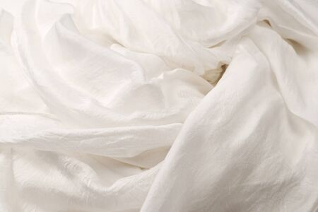 Soft smooth white silk fabric background. Fabric texture.