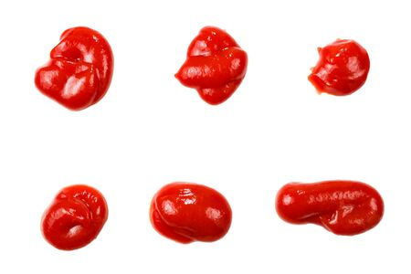 Red sauce splashes isolated on white background. Ketchup. Banco de Imagens