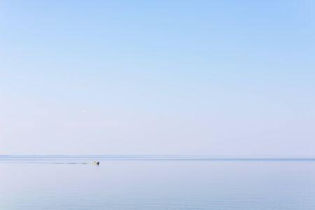 Fishermen in a boat on the lake. Stok Fotoğraf