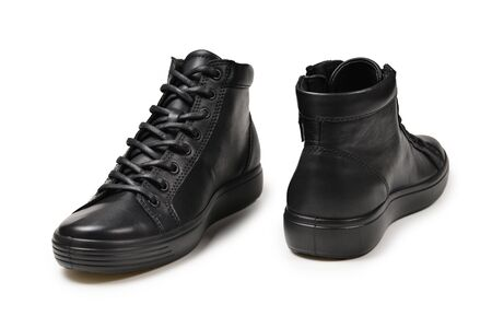 Mens black leather shoes and a black camera on a isolated on white background. Copy space. Stockfoto
