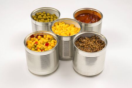 Canned food on white background. Green pea, beans, corn, lentils. Zdjęcie Seryjne
