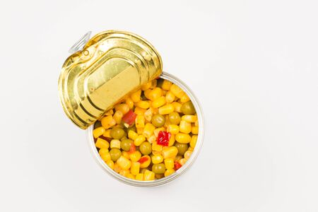 Canned food on white background. Sweet corn. Stok Fotoğraf