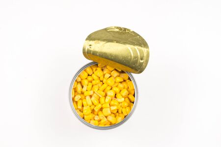 Canned food on white background. Sweet corn. Фото со стока