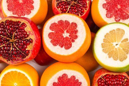 Juicy grapefruit, orange, pomegranate, citrus sweetie on white background.