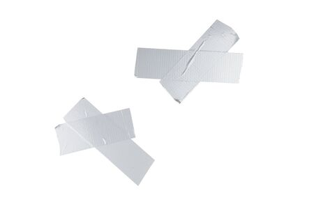 Silver scotch tape pieces isolated on white background.