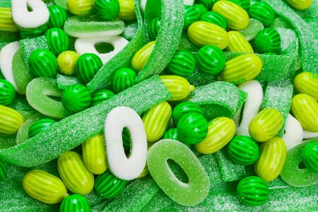 Assorted green gummy candies background. Top view. Jelly  sweets. Stockfoto