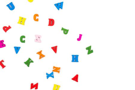Multicolored letters isolated on a white background. Top view.