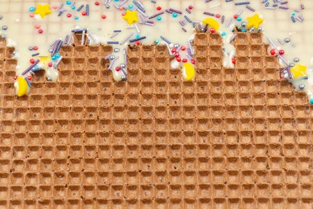 Sweet waffle background with cream. Space for text or design. 版權商用圖片