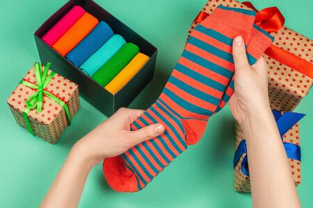 Colorful collection of cotton socks as a gift in woman hands. Gift. 版權商用圖片