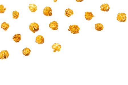 Caramel pop corn isolated on white background. Copy space.  版權商用圖片