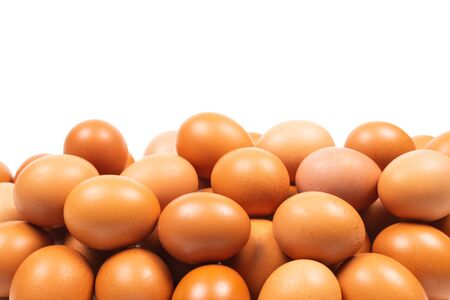 Group of brown eggs isolated on white. Copy space.