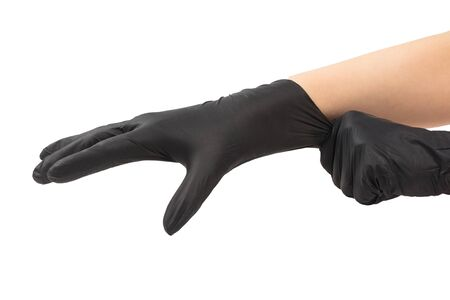 Woman puts on black rubber gloves. Isolated on white.
