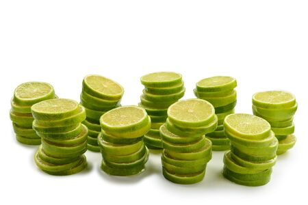 Lime slices isolated on white background. Space for text or design. 版權商用圖片