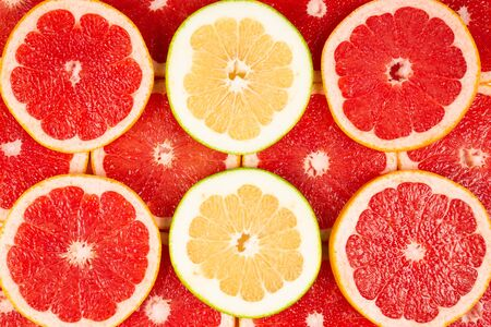 Pomelo and grapefruit juicy slices background.