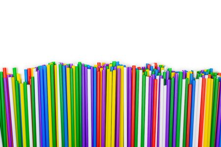 Colorful plastic tubules isolated on white. Copy space.