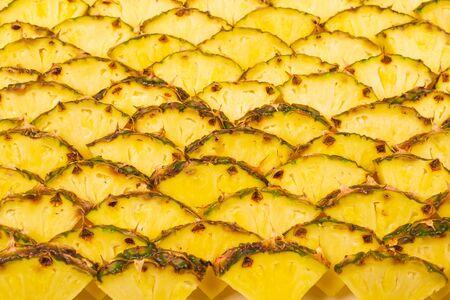 Pineapple juicy yellow slices background. Top view. 版權商用圖片