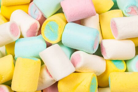 Colorful tasty marshmallow background. Top view.  Banco de Imagens