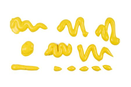 Yellow cheese sauce splashes isolated on white background. Top view.
