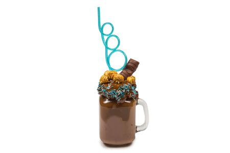 """Chocolate milkshake with whipped cream, cookies, waffles, served in glass mason jar. """"Freak or crazy"""" sweet shake. Isolated. Space for text or design."""