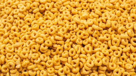 Corn-flakes background and texture. Top view. Honey rings cereal box for morning breakfast.