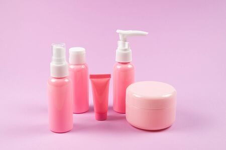 Pink plastic bottles for hygiene products, cosmetics, hygiene products on a pink background. Copy space. Stock Photo