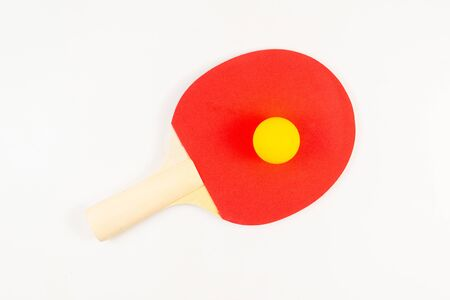 Pin pong on an orange background. Top view.
