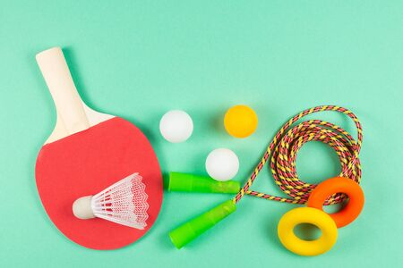 Sport equipment on green background. Copy space.