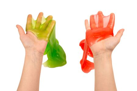 Green and red slime toy in woman hand isolated on white. Top view.
