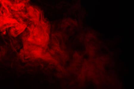 Red steam on a black background. Copy space.
