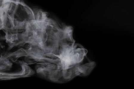 White steam on a black background. Copy space. Stockfoto