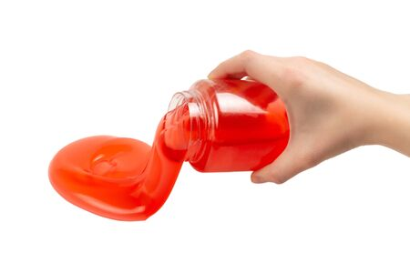 Red slime toy in woman hand isolated on white. Top view.
