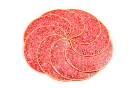 Tasty salami slices isolated on white background.