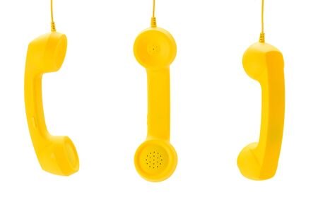 Yellow handset isolated on white. Copy space.