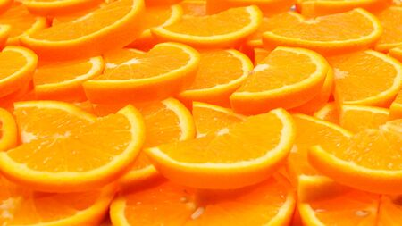 Slices of oranges as a background, top view.