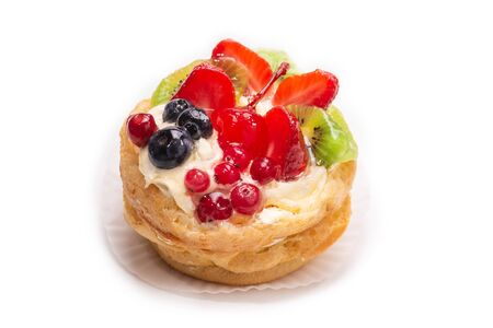 Home made cake with cream and fruits isolated on white.