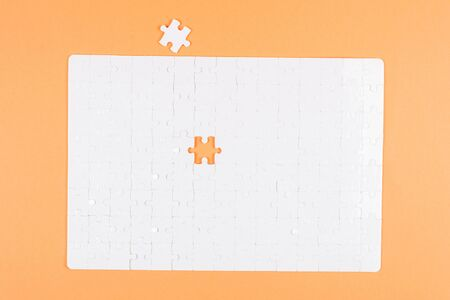 White puzzle background. Top view. Stock Photo