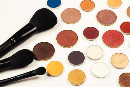 Round multicolored make up eyeshadows isolated on white. Top view.