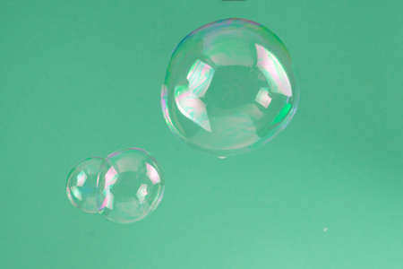Soap bubbles isolated on a black background. Copy space.