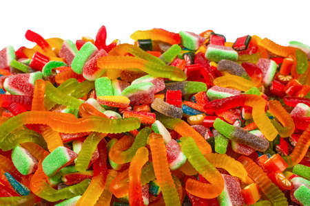 Assorted tasty gummy candies. Top view. Jelly sweets background. 版權商用圖片