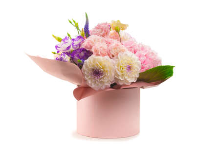 Pink and purple bouquet of flowers in a pink box isolated on white background.