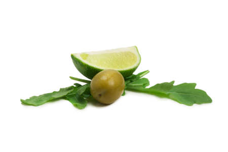 Two olives, piece of lemon and leaves of arugula isolated on white background.