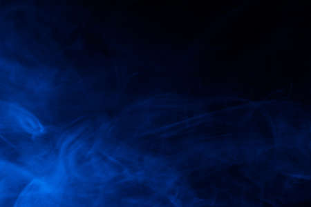 Blue steam on a black background. Copy space.