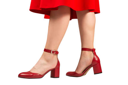 Woman in red dress and in retro red sandals on heels isolated on white background. Archivio Fotografico