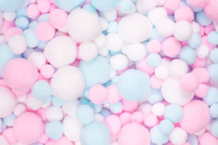 White, pink and blue soft pompons background.