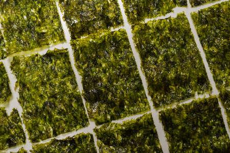 Tasty nori seaweed isolated on white background.